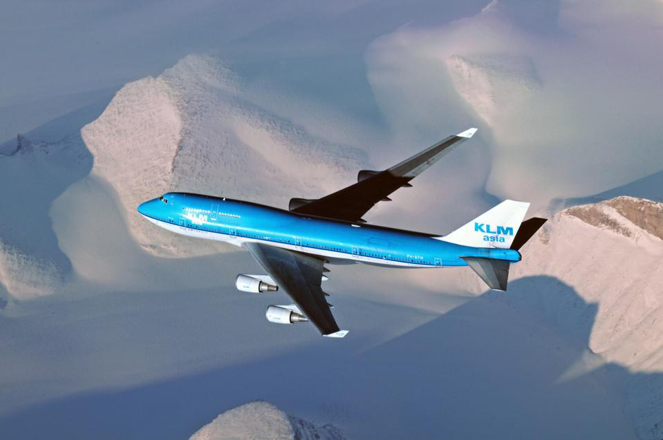 Greenland - : KLM Asia Boeing B747-400 is flying above the snowy mountains of Greenland