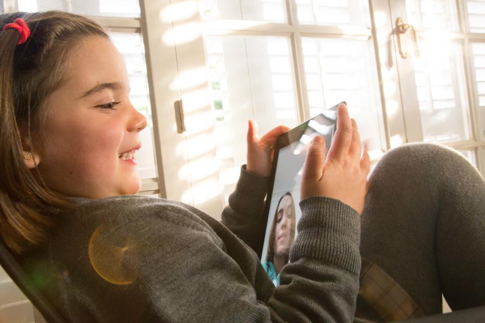 Young girl doing FaceTime on Ipad.