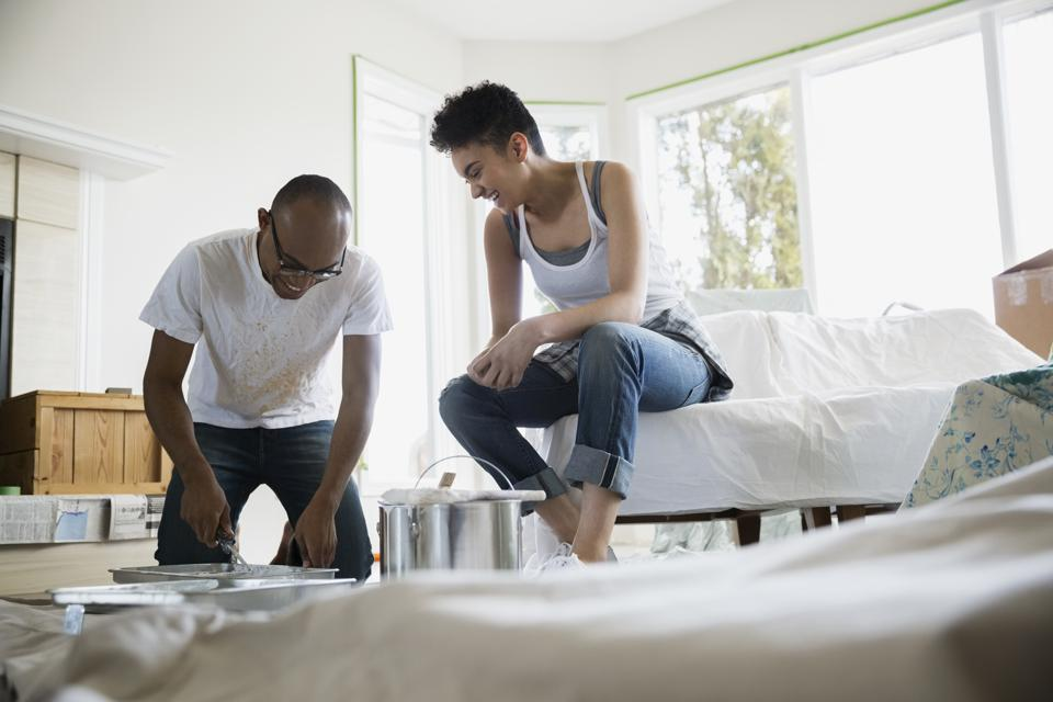 Couple preparing to paint living room