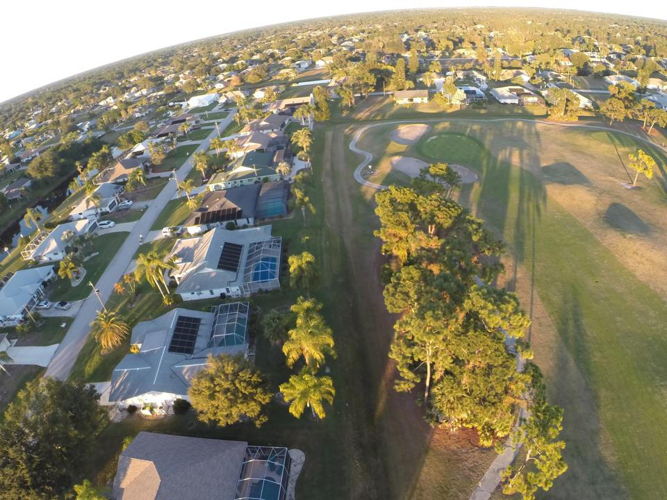 Houses surround the Palms golf course in Rotonda West, Florida.