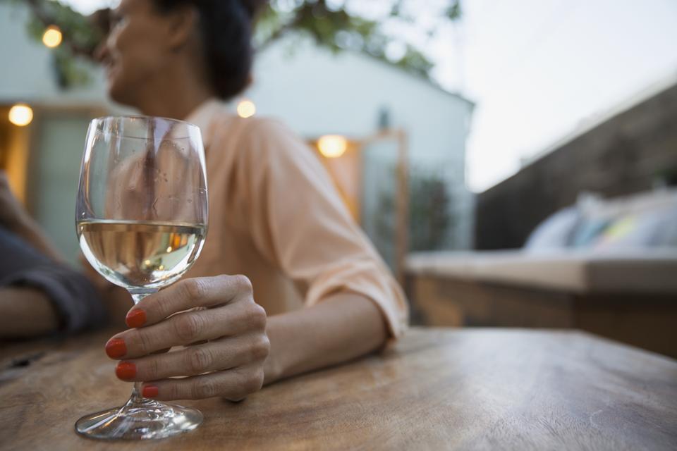 Woman drinking white wine on patio, white wine, summer wine