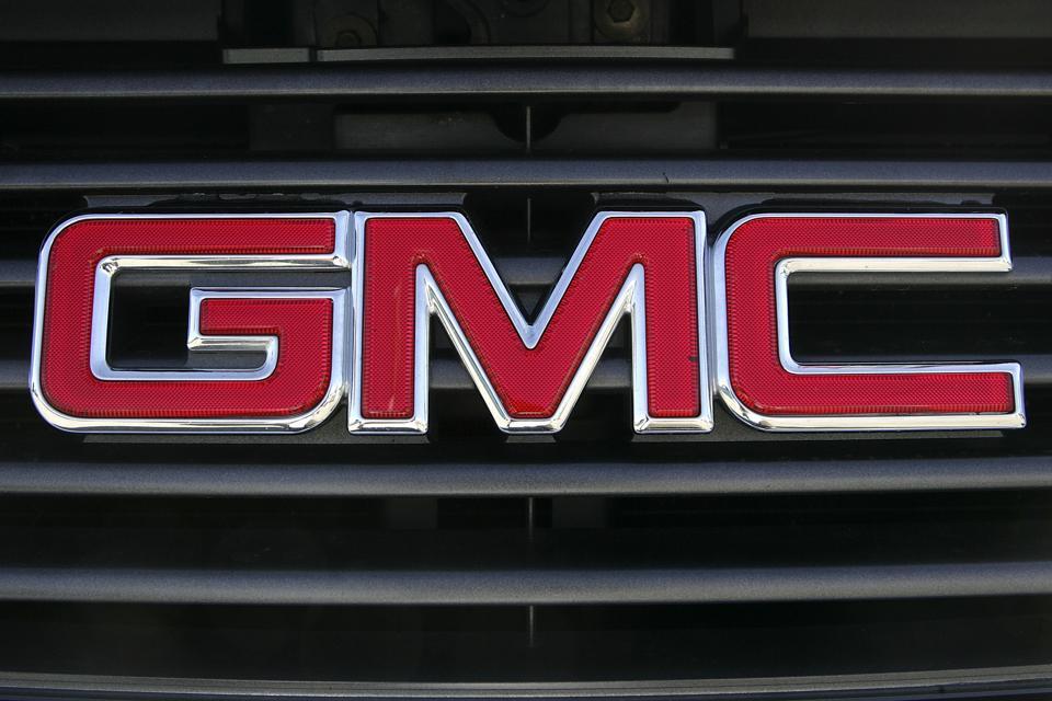 GM Posts Massive Loss, Cuts Health Benefits