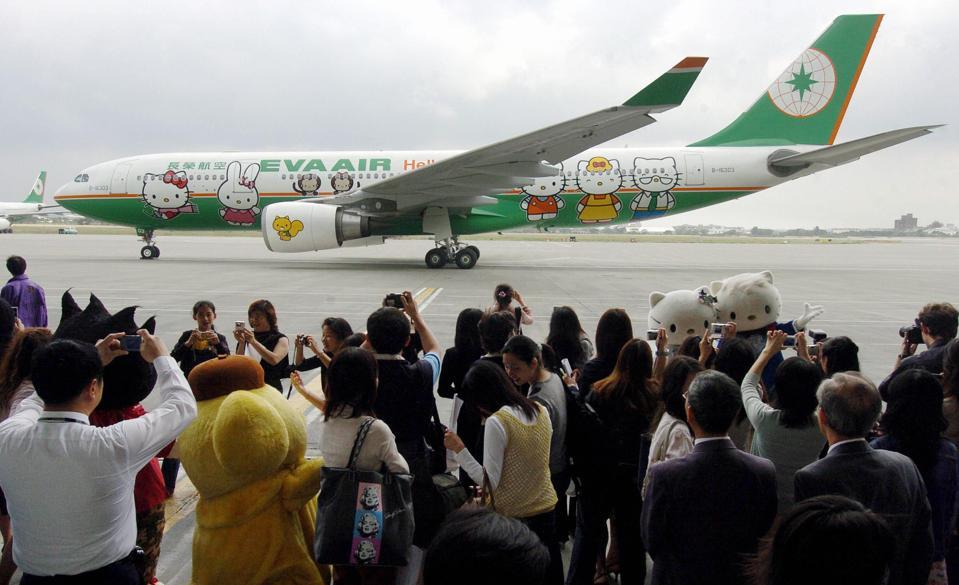 Local journalists take photos of EVA air