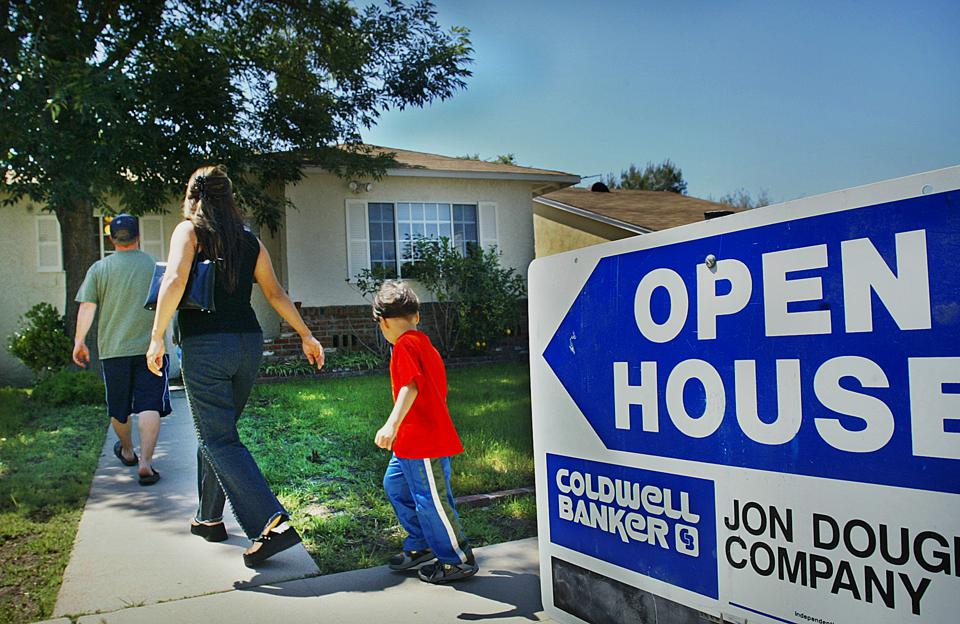 Open house on a home for sale in Sherman Oaks. Pic. shows a house seeker with family going to the op