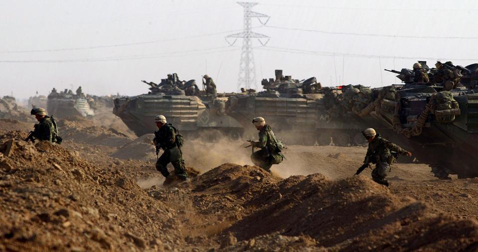 FG.war.airattack.3.23.RL––Iraq––03/23/2003––Marines run away from the amphibious assault vehicles in