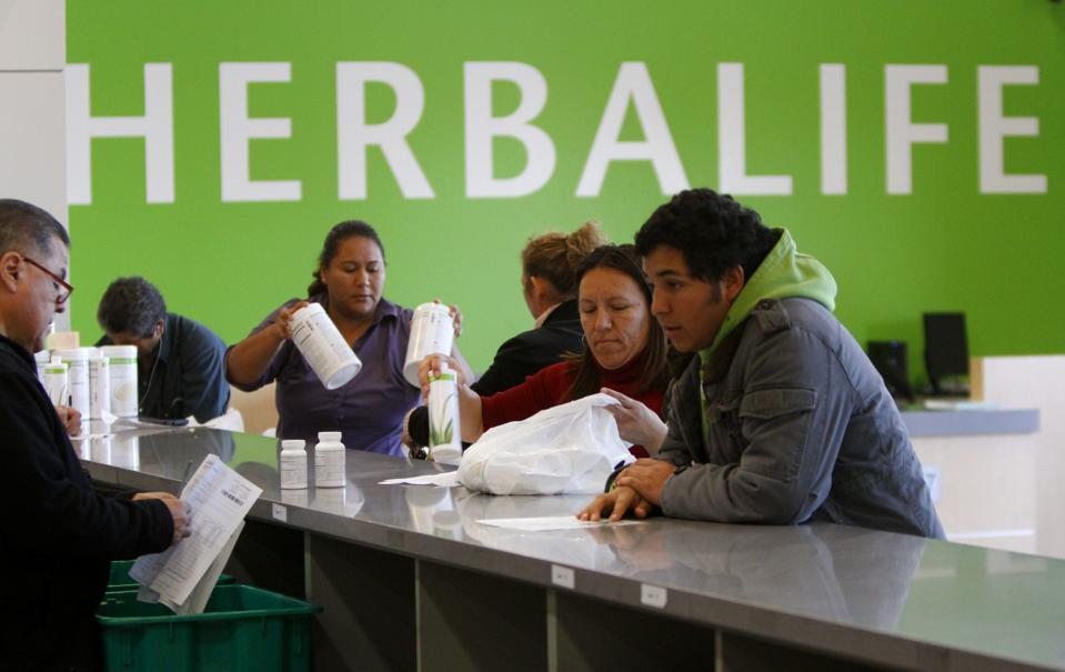 Distributors line up at the main counter at the Herbalife Distribution Center in Carson, California in January 2013.