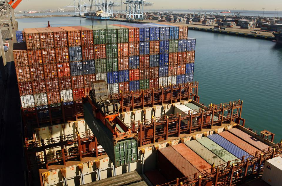Los Angeles, Ca. – Shipping containers are offloaded from the container ship APL Singapore onto Ter