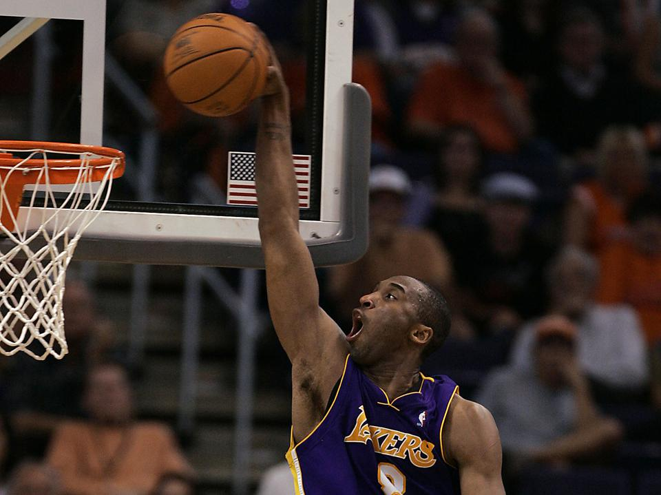 Laker Kobe Bryant goes for the dunk over the Phoenix Suns Steve Nash in the fourth quarter with emp