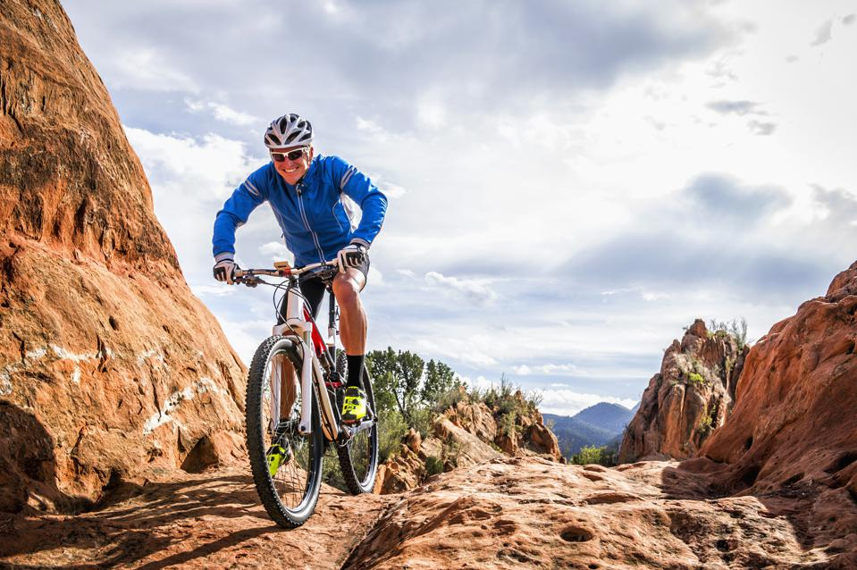 Caucasian man riding mountain bike on mountain