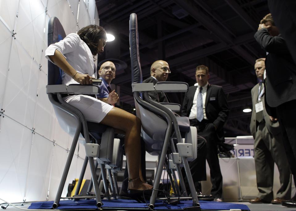 Vendors and exhibitors try out the new SkyRider seats by Aviointeriors at the Aircraft Interior Exp