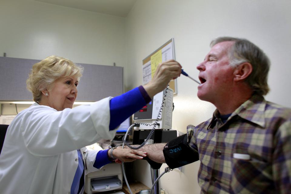 LONG BEACH, CA --MARCH 22, 2011-- Jeffrey Grimes, 56, from Long Beach, has vitals taken by Maria Sera