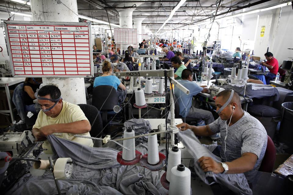 LOS ANGELES, CA-July 10, 2014: American Apparel garment workers are busy at work
