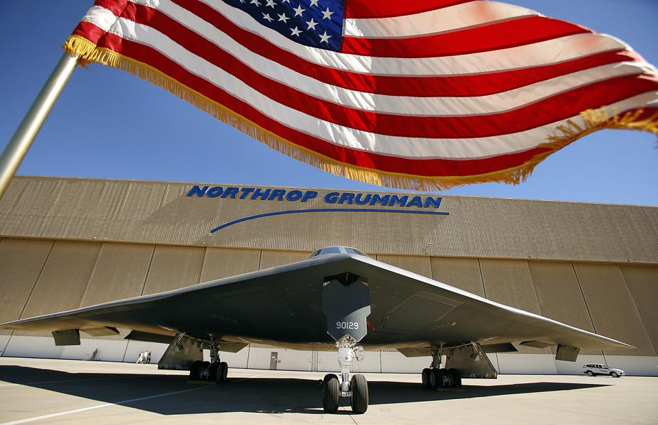 PALMDALE, CA  JULY 17, 2014 -- The US flag flies near the U.S. Air Force's B-2 Spirit Stealth bomber