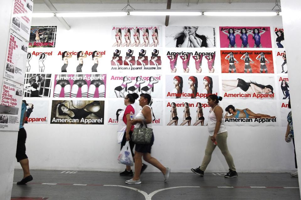 LOS ANGELES, CA-July 10, 2014: American Apparel garment workers are busy at work inside the Los Ange
