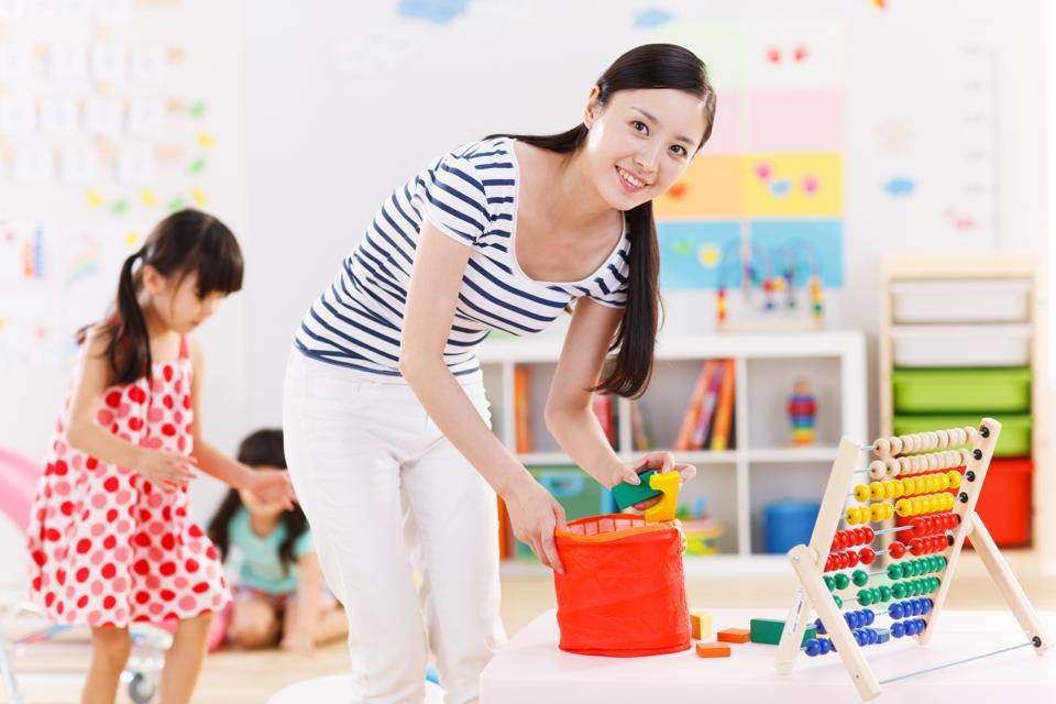 The kindergarten teachers and children