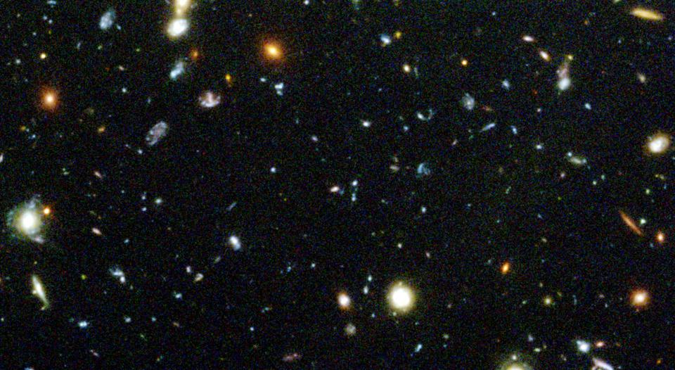 A small section of the original Hubble Deep Field, featuring hundreds of galaxies.