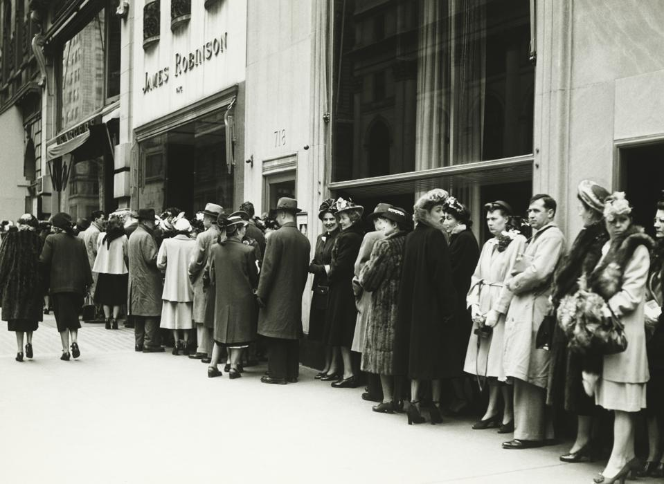 People standing in line at James Robinson cinema, NY, (B&W)