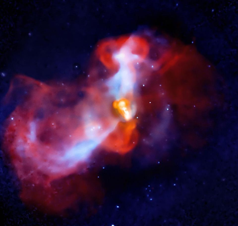 An X-ray/radio composite shows a supermassive black hole actively feeding inside a galaxy.