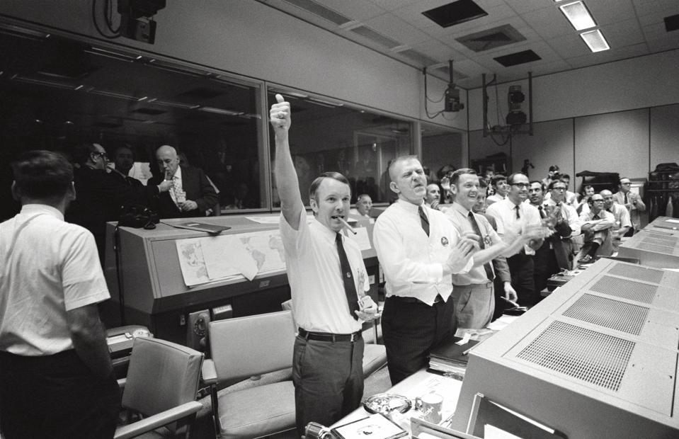Mission control celebrating the successful splashdown of Apollo 13 in 1970.