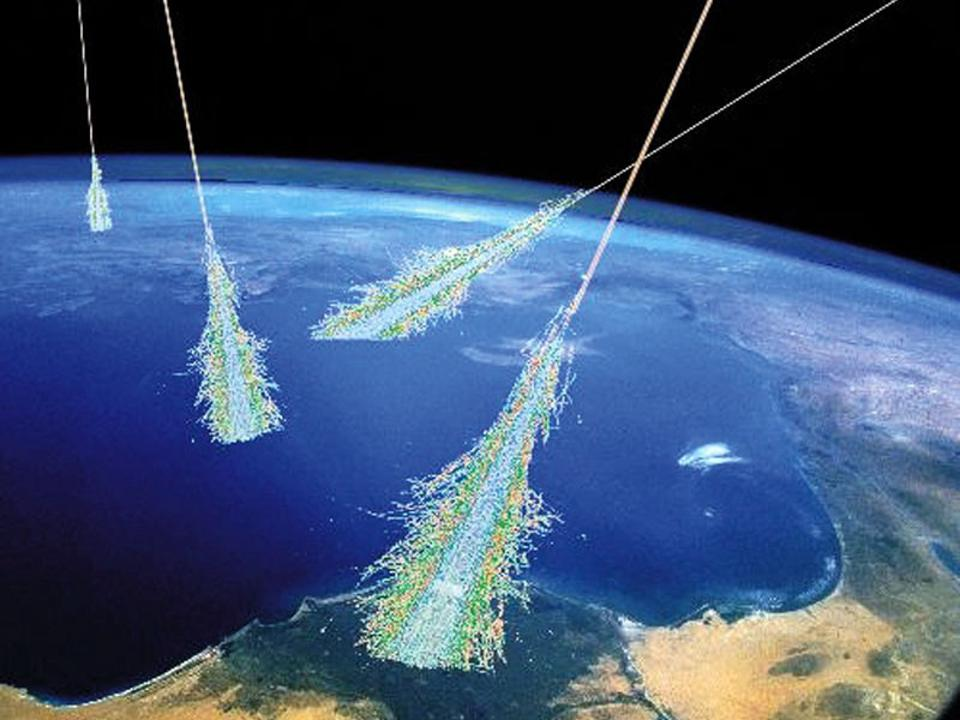 An illustration of cosmic rays striking Earth's atmosphere.