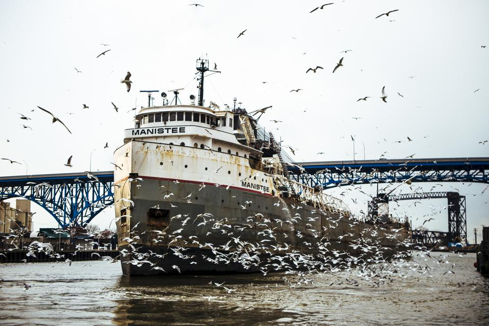 Freighter is towed down Cuyahoga River