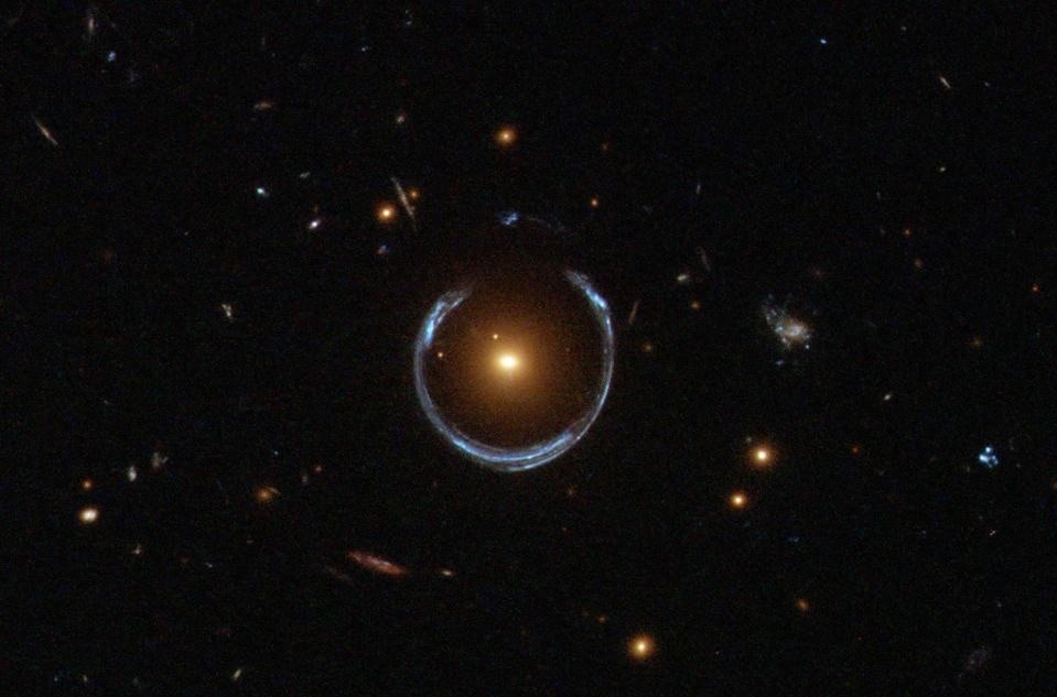 A near-perfect ring from the gravitational lensing effect of the foreground mass.