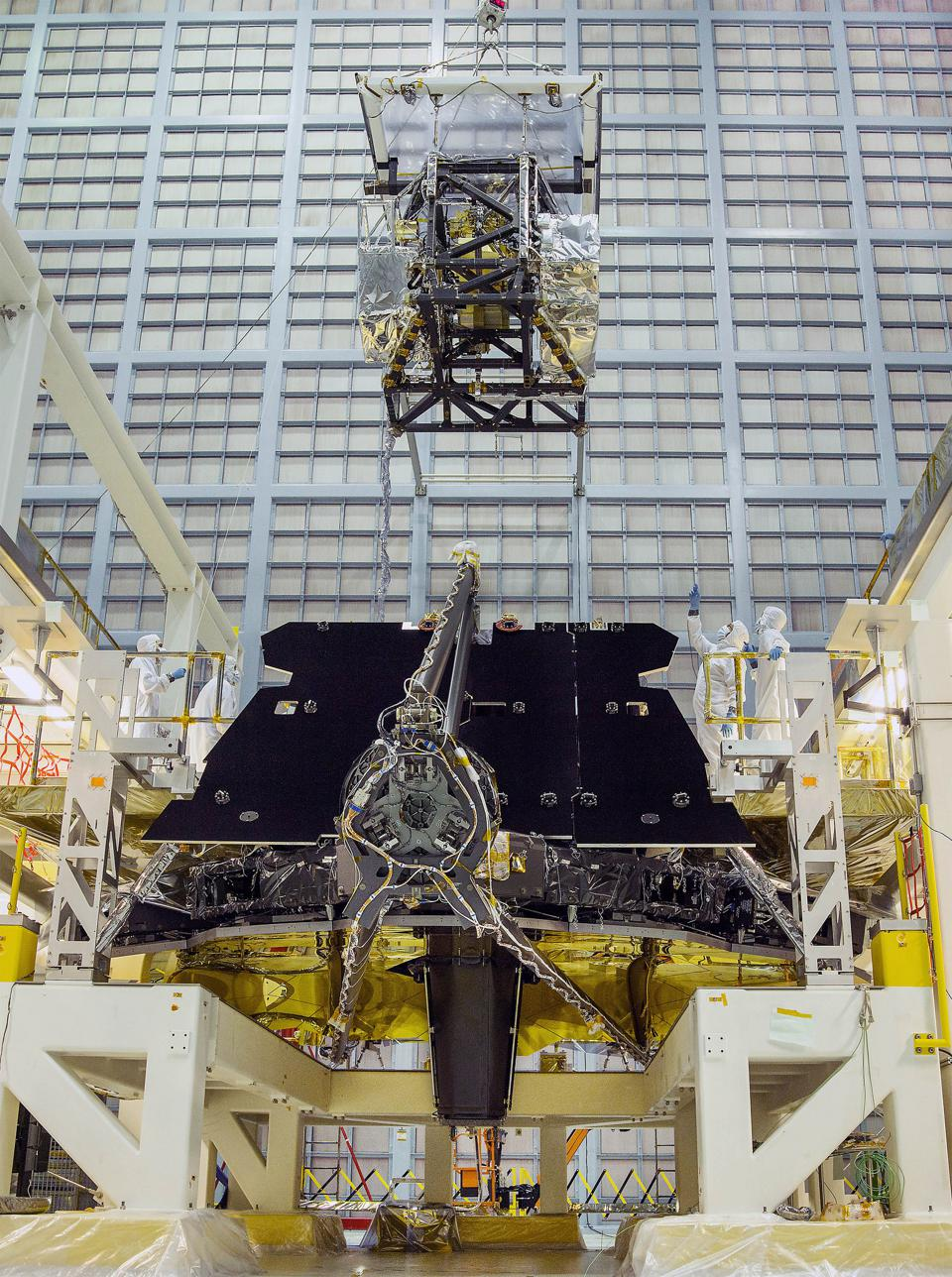 The science instruments aboard the ISIM module being lowered and installed onto JWST.