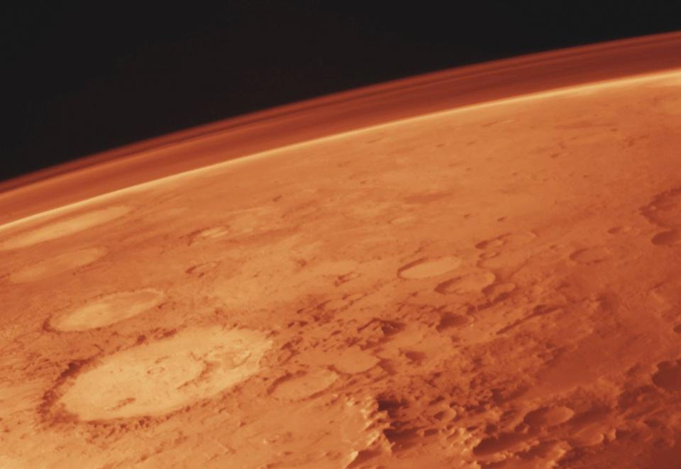 Mars, along with its thin atmosphere, as photographed from the Viking orbiter.