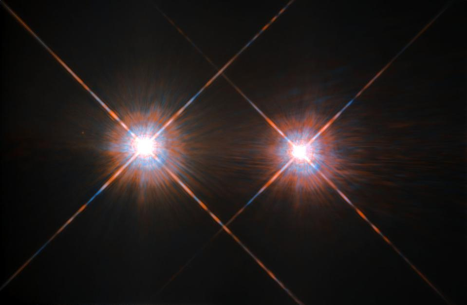 The two sun-like stars, Alpha Centauri A and B, are located just 4.37 light-years away.
