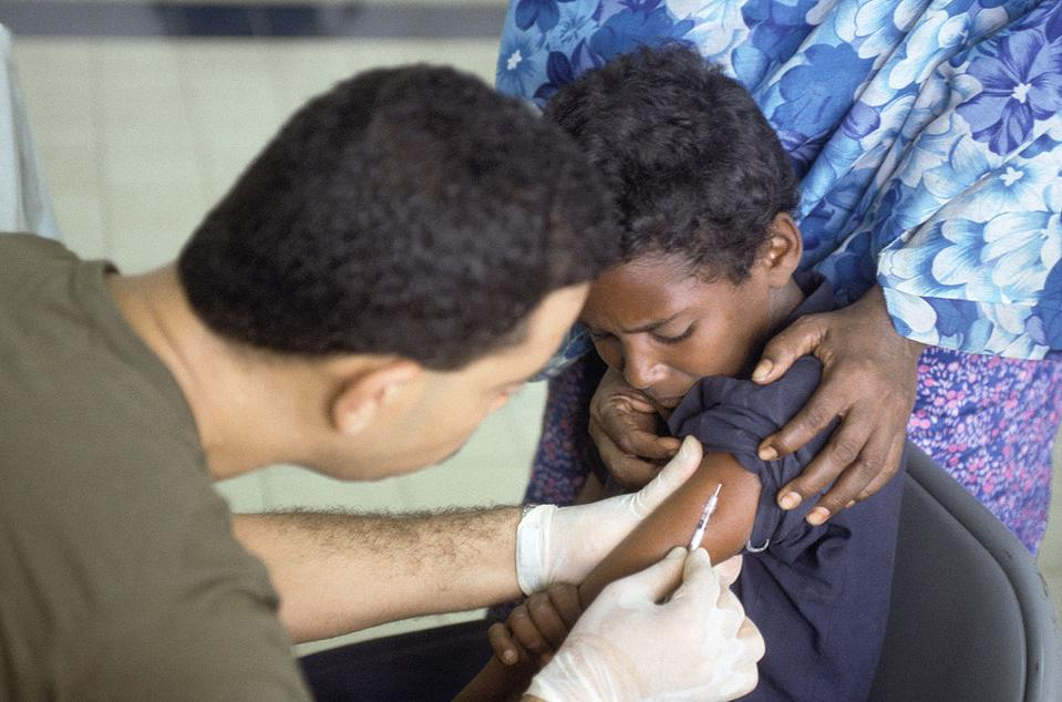 A Somali boy receives a polio vaccination in 1993.