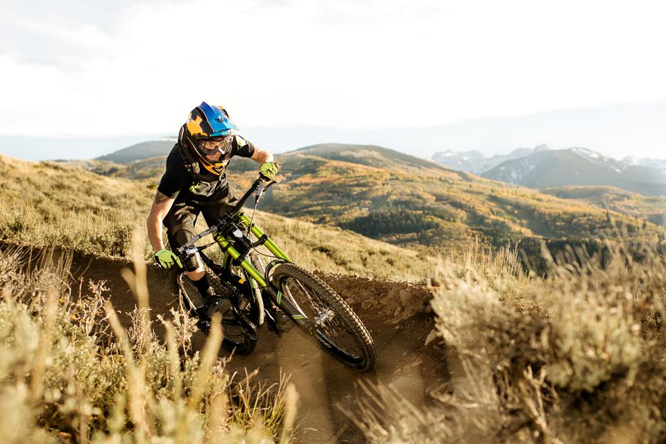 Female biker riding down the mountain.