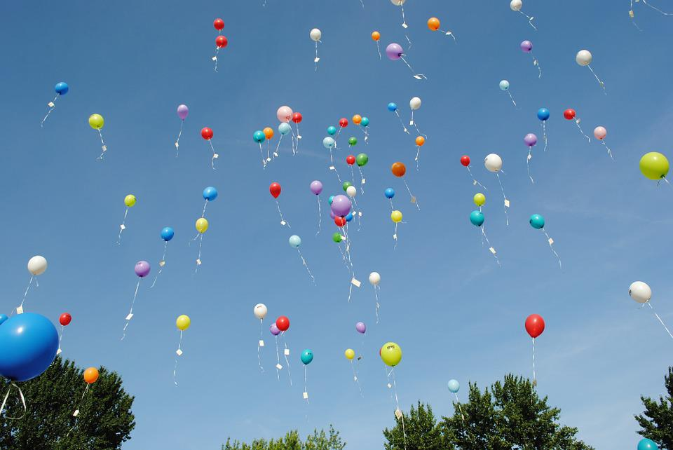 Helium balloons, where the vast majority of the helium inside will escape the Earth.