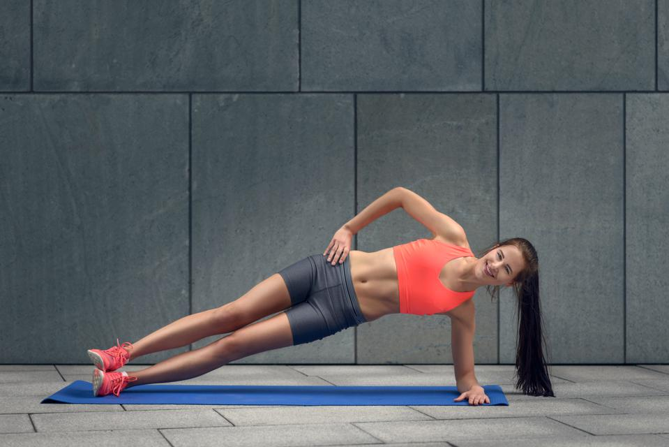 Fit young woman doing planks