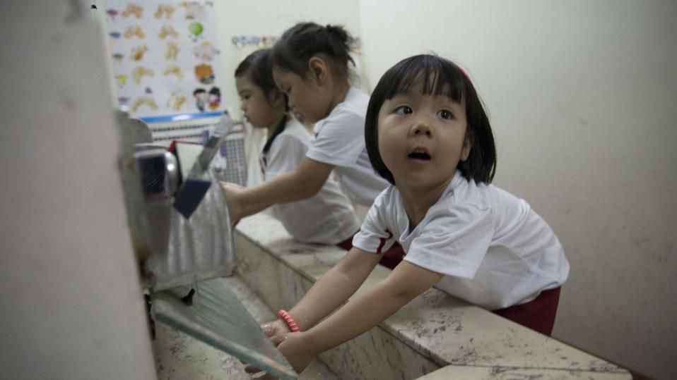 Students washing hand at Sakura Montessori international...