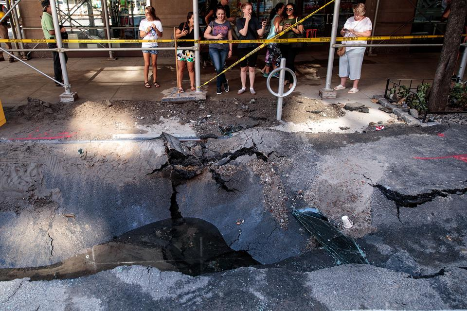 Sinkhole Forms In Manhattan After Water Main Break