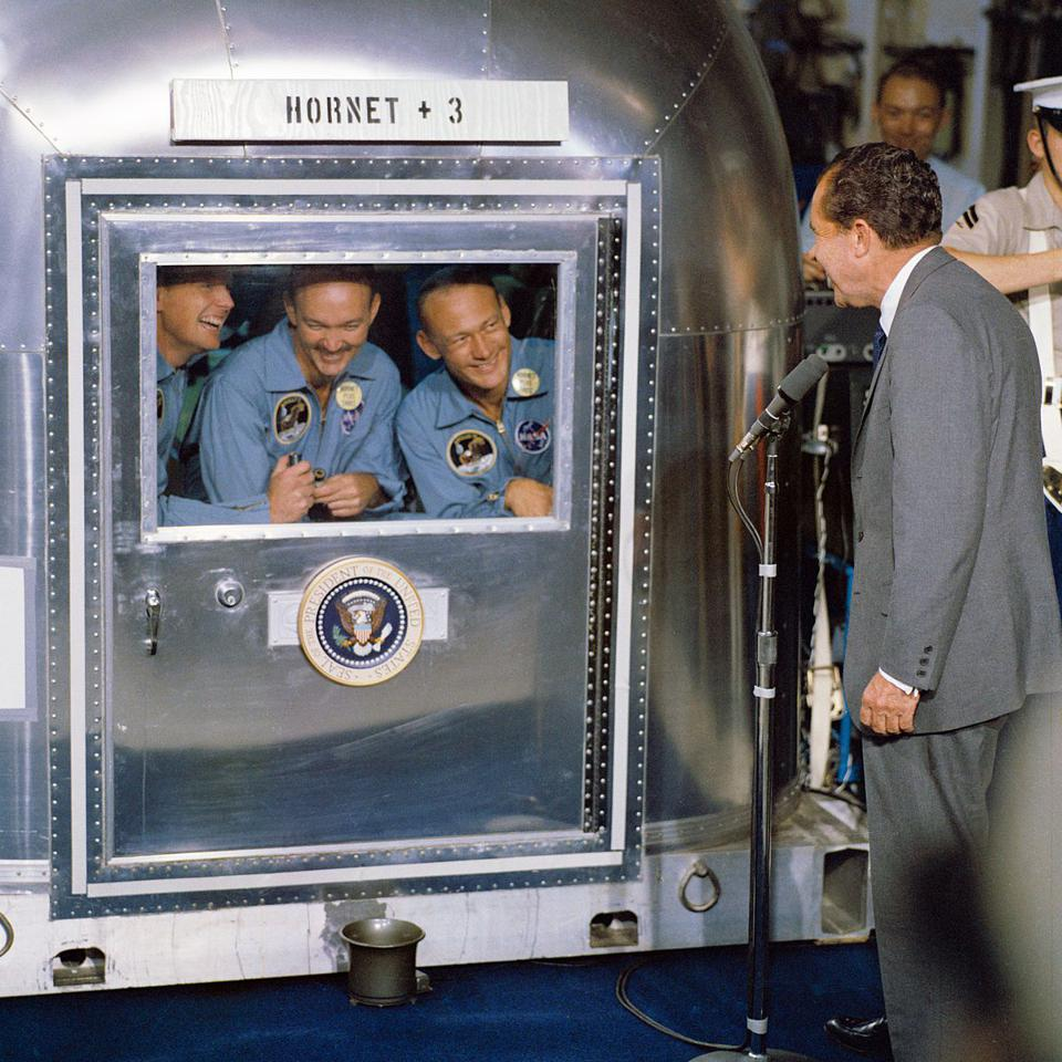 The crew of Apollo 11 — Armstrong, Collins, and Aldrin — in the Mobile Quarantine Facility