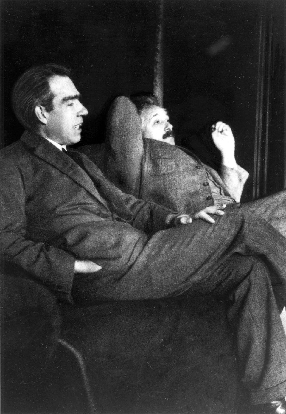 Niels Bohr and Albert Einstein, discussing topics in the home of Paul Ehrenfest in 1925.