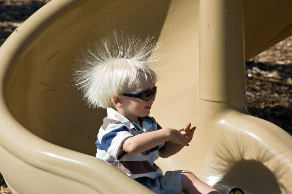 The effect of static electricity on a child's hair.