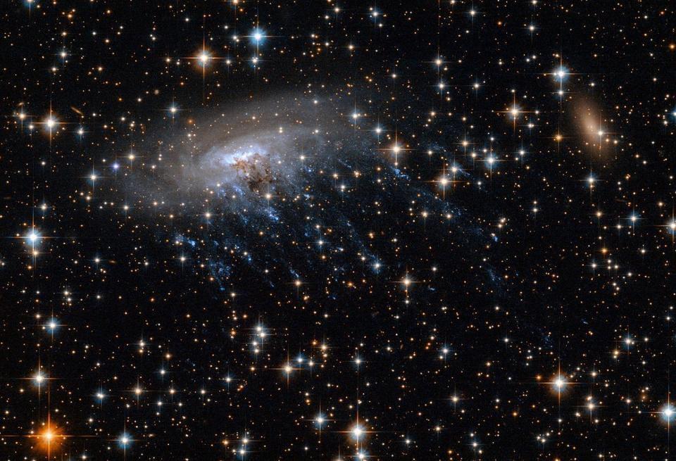 Gas stripping occurring for galaxies that speed through a matter-rich medium.