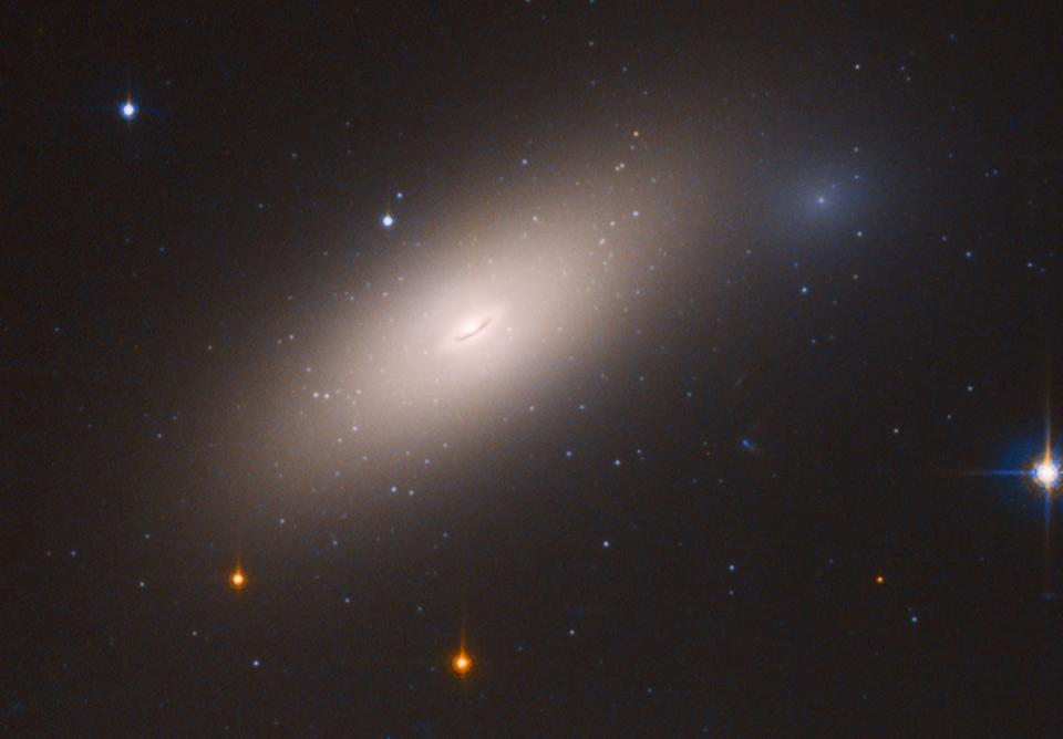 Galaxy NGC 1277: the first known 'red and dead' galaxy in our own cosmic backyard.