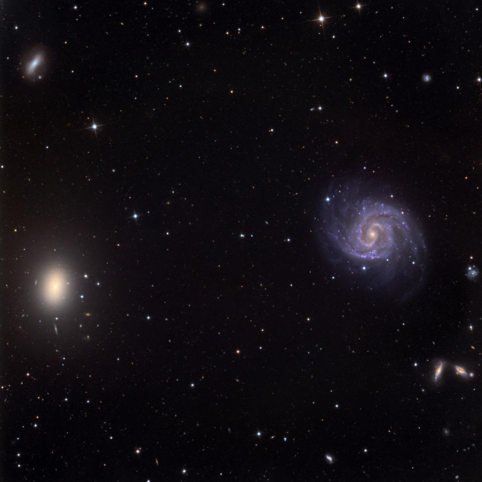 A wide-field view that includes galaxies NGC 1052 and NGC 1042.
