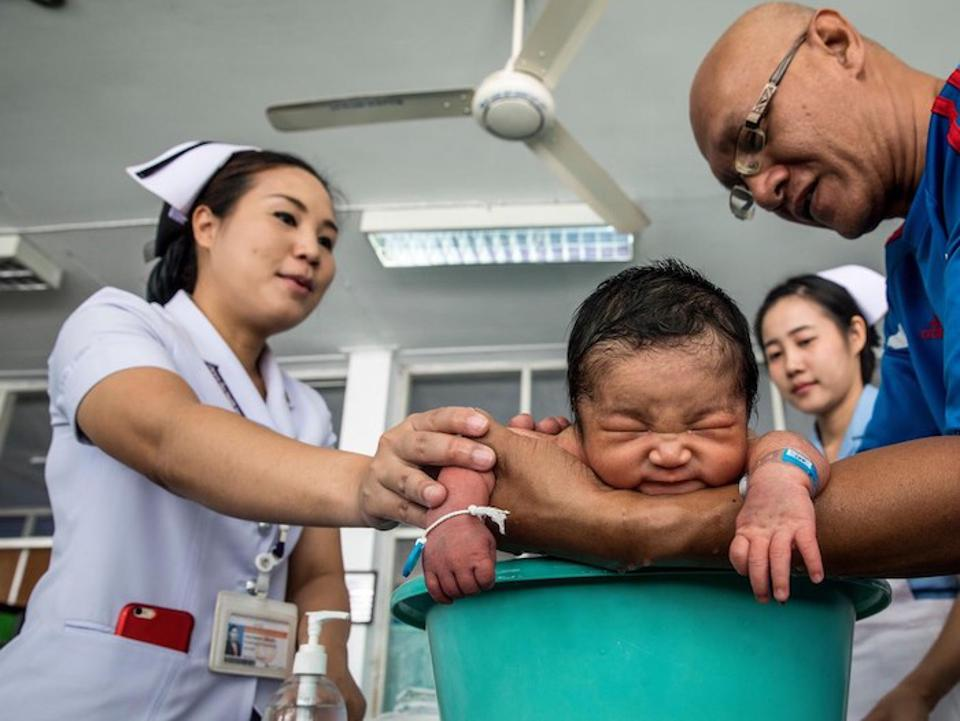 First-time father Somsak Hameyai bathes his two-day-old son, Sailom, during a parenting class at the Health Promotion Center Region 1 in Chiang Mai, Thailand.