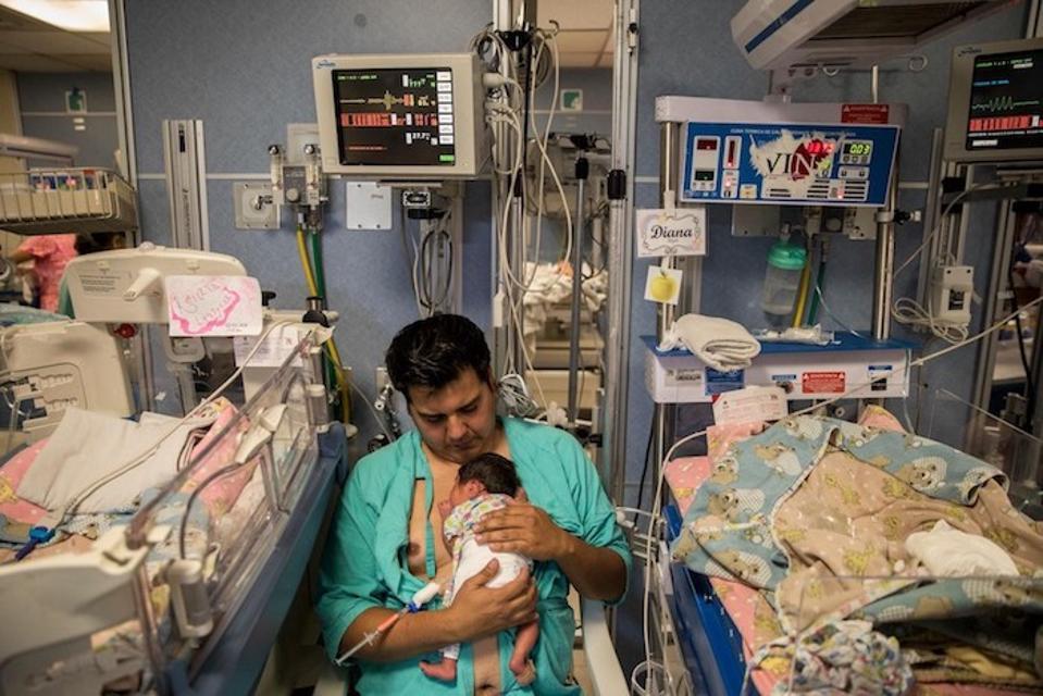 Gerardo Brito Rodriguez holds his 13-day-old premature newborn daughter, Diana, against his chest in the Instituto Nacional de Perinatología Hospital in Mexico City.