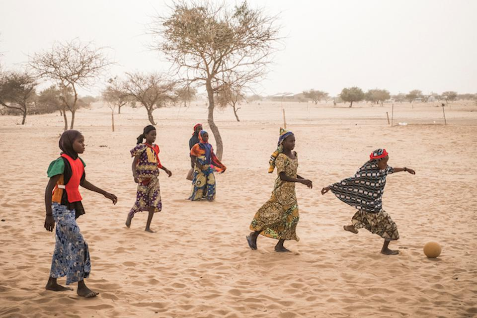 Nigerian refugees displaced by Boko Haram militants play football in Daresalam refugee camp, Lake Region, Chad in 2017.