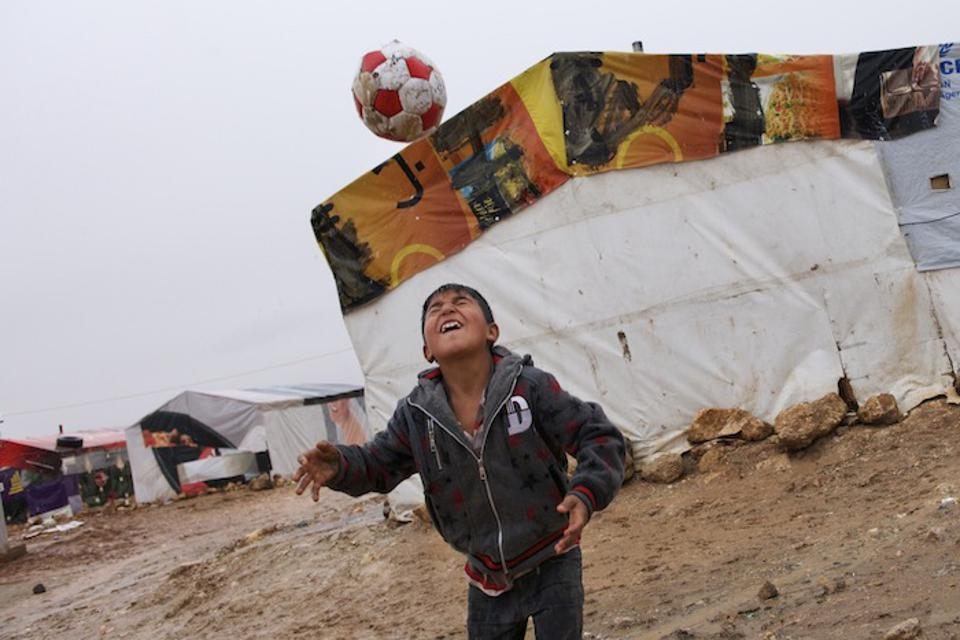 Outside a family's tent shelter in 2013 in the Tal Al Abiad settlement for Syrian refugees in Baalbek, Lebanon.