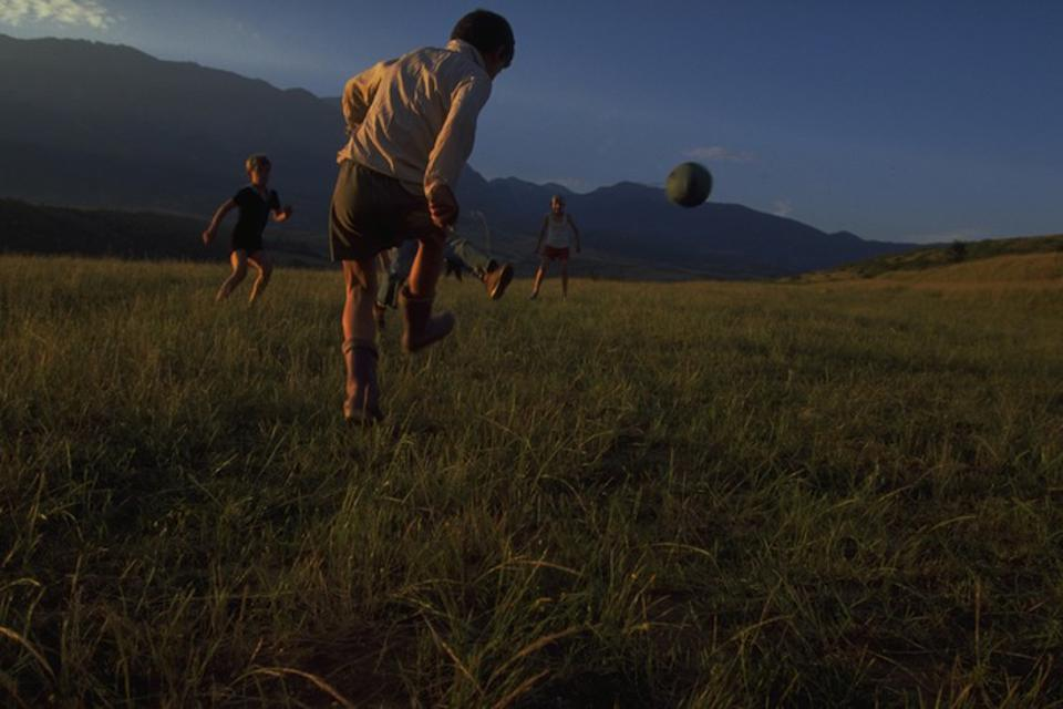 In a field used for play by refugees from Kosovo in 1998, near the town of Bajram Curri, Albania.