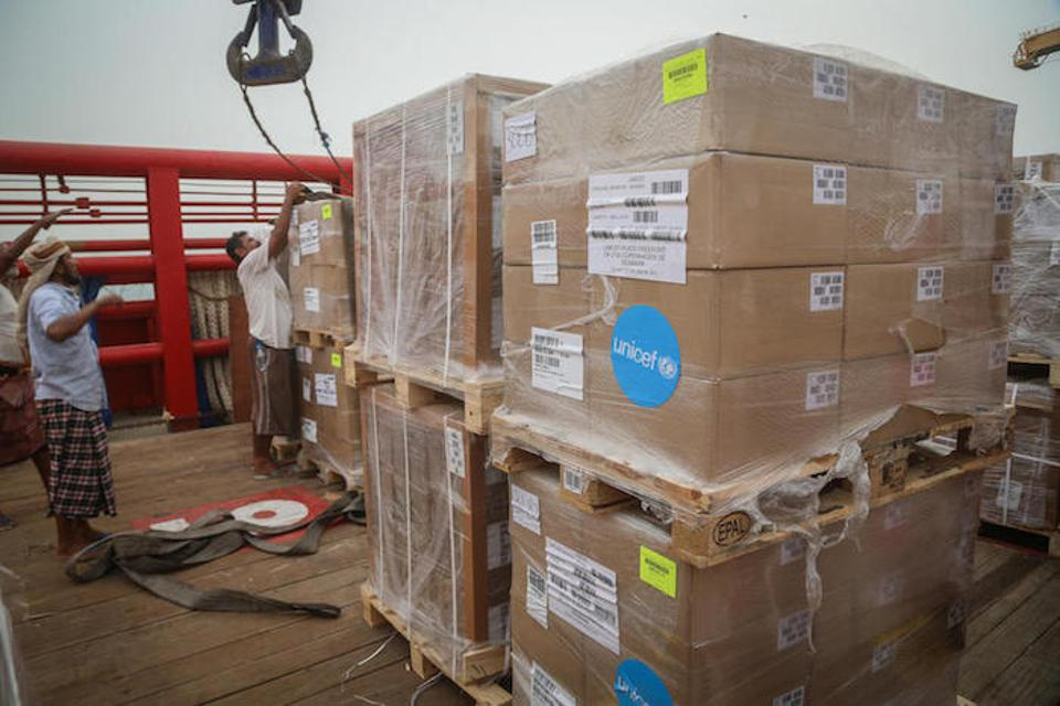 A ship berths in the port and emergency humanitarian supplies sent by UNICEF are offloaded in Hodeida, Yemen.