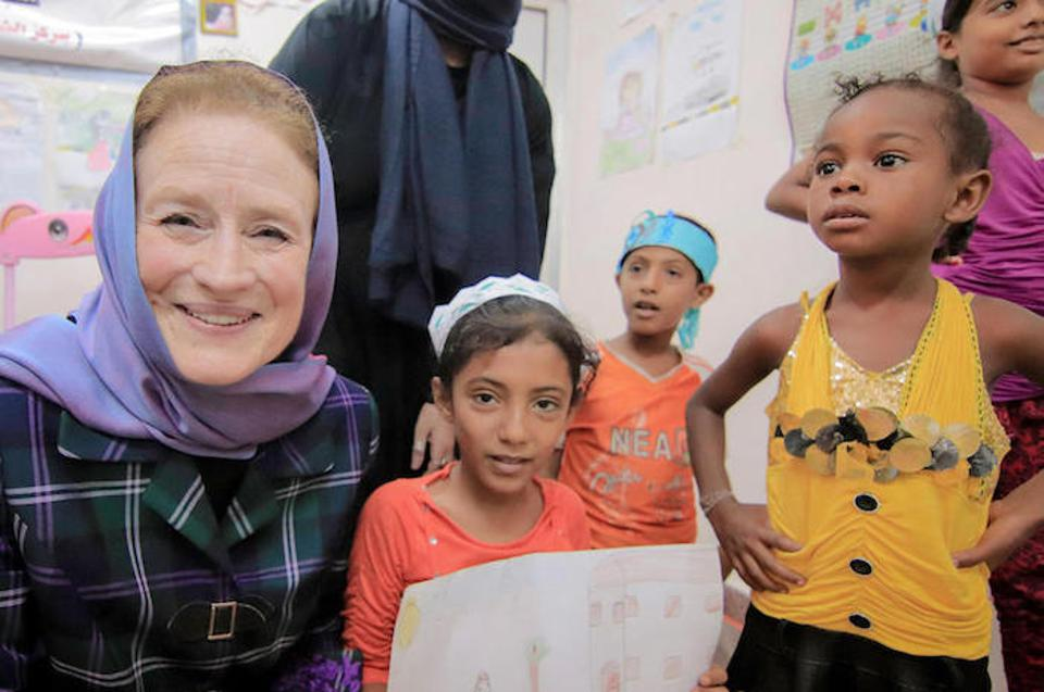 UNICEF Executive Director Henrietta H. Fore (far left) visits with children at the Child-Friendly Space at the Alqatee'a Health Center in Aden, Yemen.