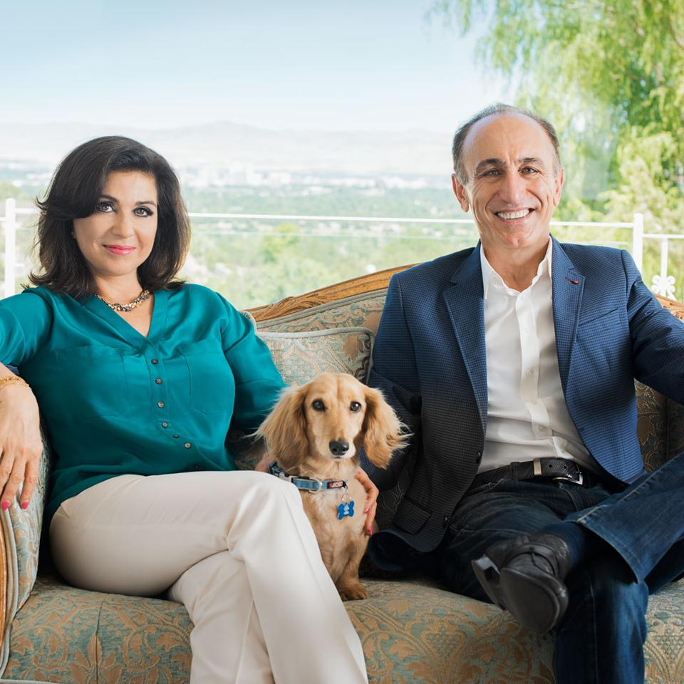 The husband-and-wife co-owners of Sierra Nevada Corp., Eren and Fatih Ozmen, and their long-haired dachshund Peanut, at their home in Reno.