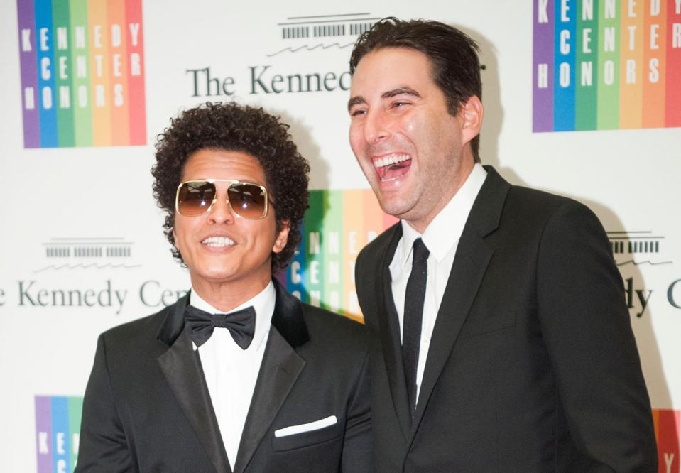 Bruno Mars and his then manager Brandon Creed share a laugh on the red carpet at the State Department Dinner for the Kennedy Center Honors in 2014.